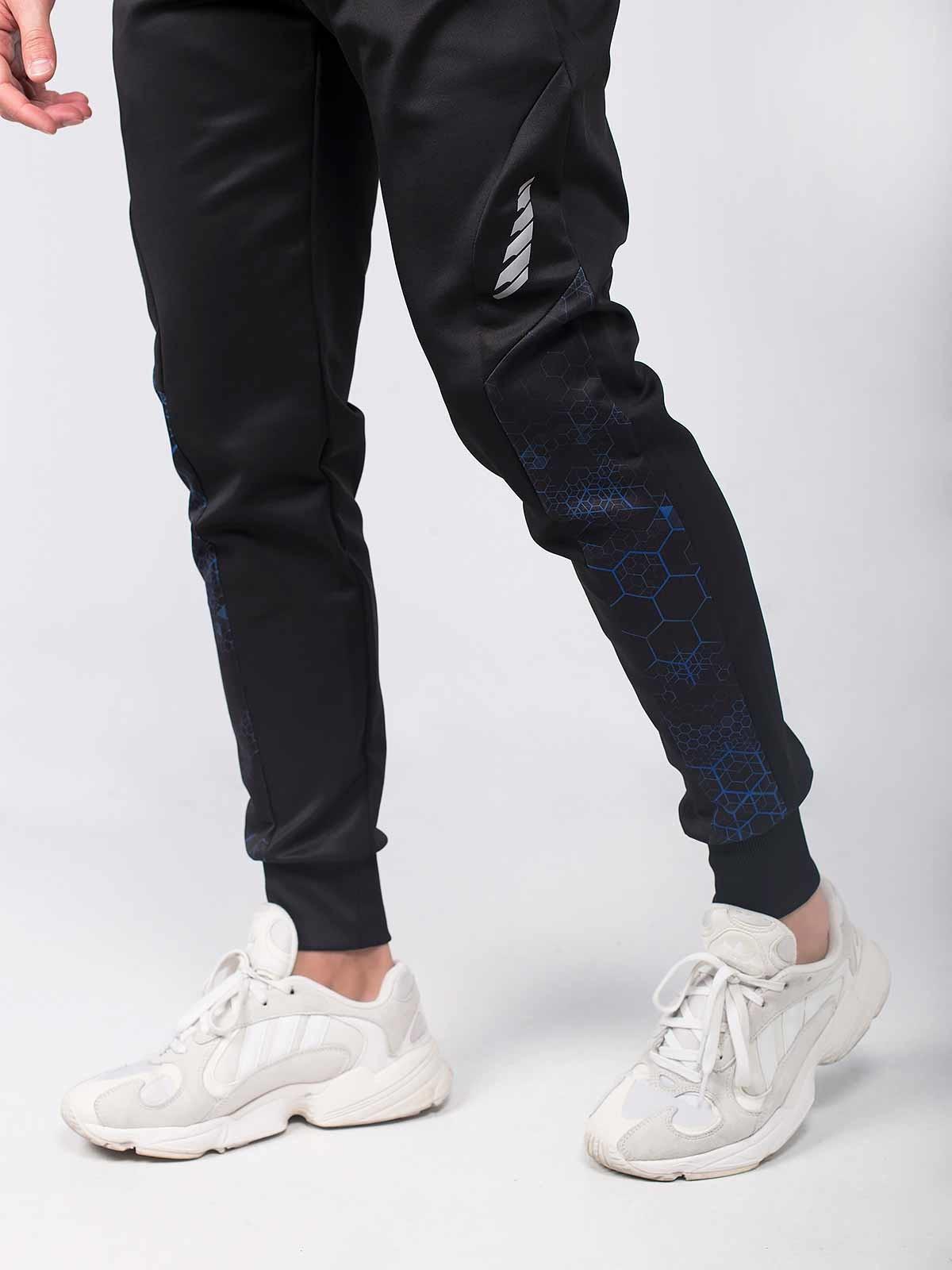 Pantalones deportivos negros estampado