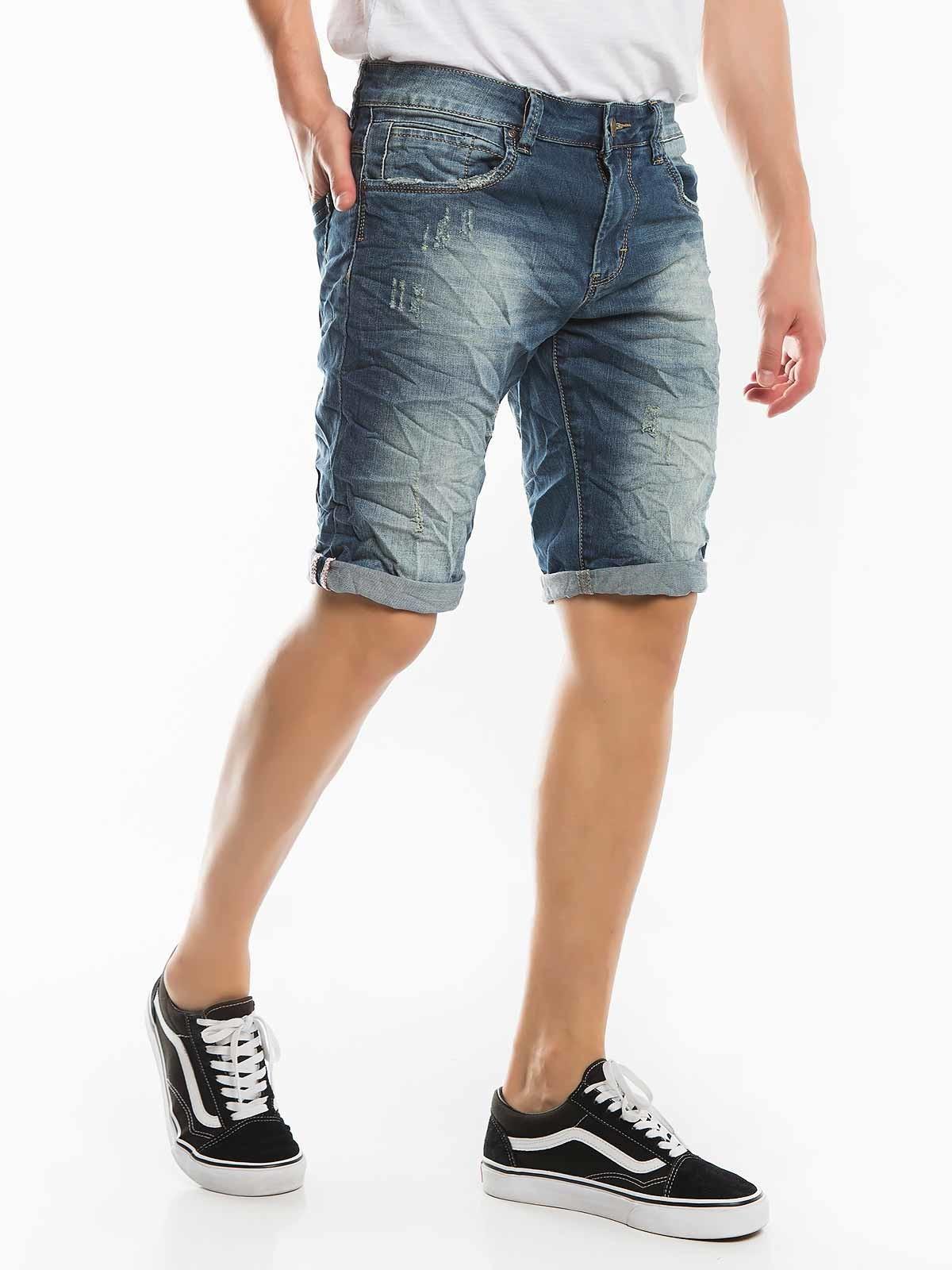 Pantalones cortos de mezclilla manchada rasgada