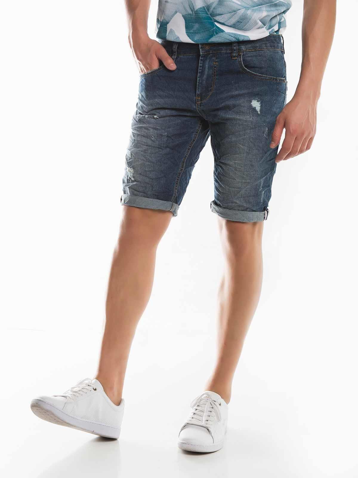 Pantalones cortos de mezclilla ajustados rotos