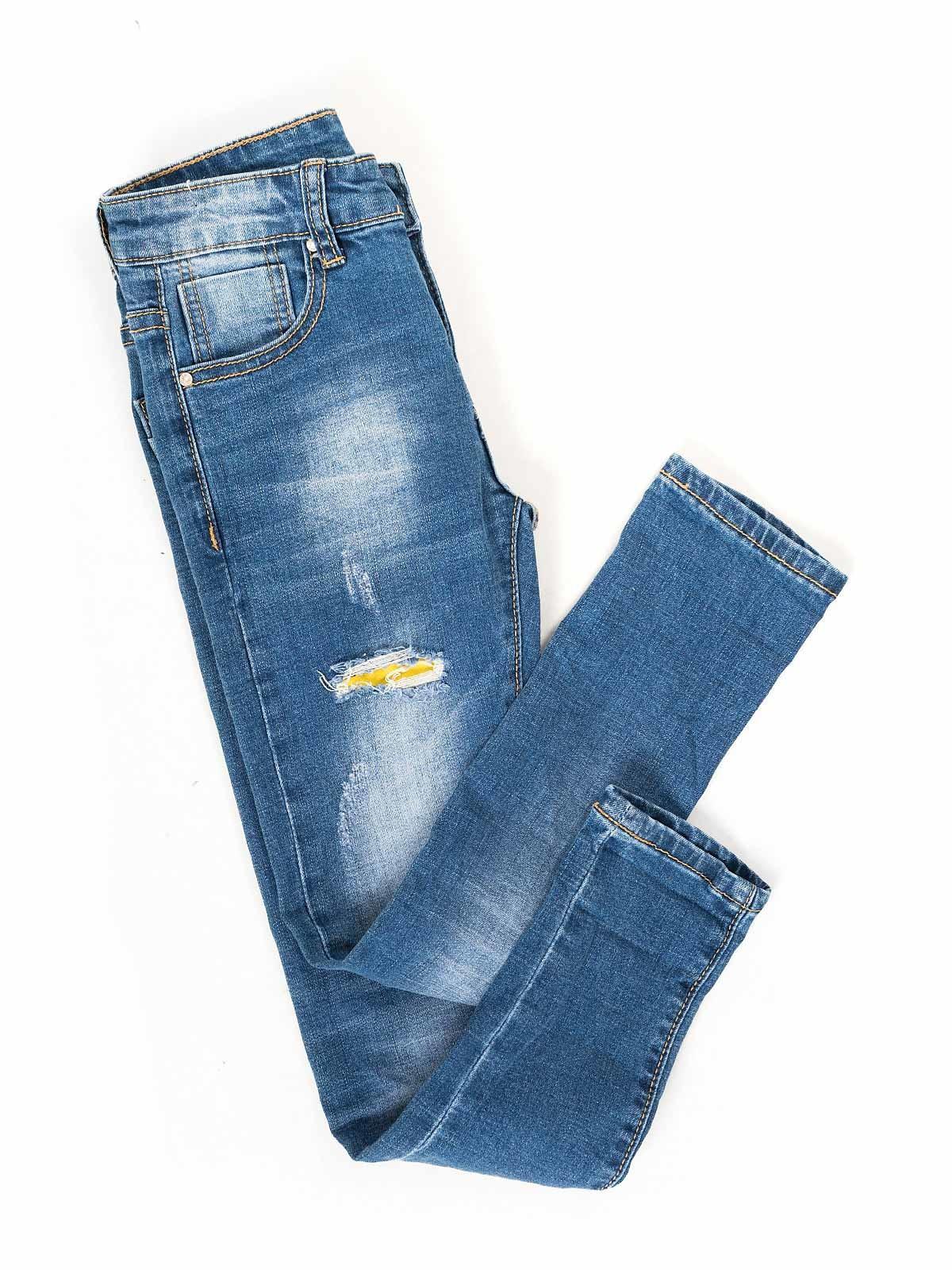 Calças de ganga elástica com rotos